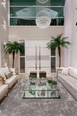 Casa Buriti: Salas de estar modernas por Arquiteto Aquiles Nícolas Kílaris