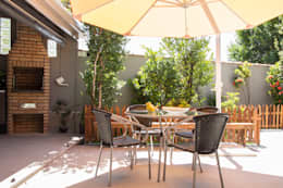 Jardines de estilo tropical de Marcos Contrera Arquitetura & Interiores