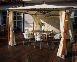 Balconies, verandas & terraces  by Ogrodowy Salon