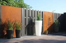 Decoratie: eclectische Tuin door Saffrane