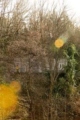 Fachada Norte : Casas de estilo ecléctico de BATLLÓ CONCEPT