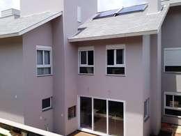 Casas de estilo moderno por Tuti Arquitetura
