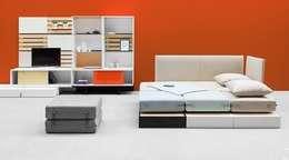 Salas de estilo moderno por NOTI