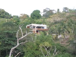 LAUTE house - from the lagoon: Maisons de style de style Tropical par STUDY CASE sas d'Architecture