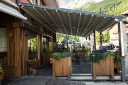 Balcones y terrazas de estilo moderno por Parolini tende