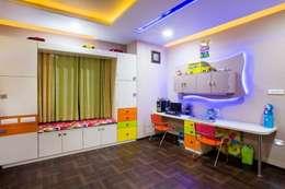 غرفة الاطفال تنفيذ Srujan Interiors & Architects Pvt Ltd