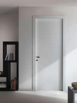 Projekty, nowoczesne Okna i drzwi zaprojektowane przez PIETRELLI PORTE