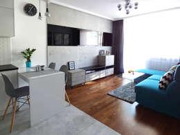 Realizacja projektu mieszkania 35m2-przed i po: styl , w kategorii Salon zaprojektowany przez Interiori Pracownia Architektury Wnętrz