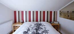 DORMITORIO ABUHARDILLADO: Dormitorios de estilo moderno de PRIBURGOS SLU