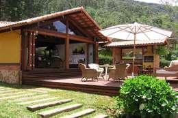Projekty, rustykalne Domy zaprojektowane przez Cadore Arquitetura