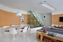 Salas de estilo moderno por Cadore Arquitetura