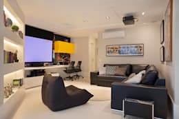 Cobertura Duplex Edificio Mandarim - Condomínio Peninsula: Salas multimídia modernas por Cadore Arquitetura