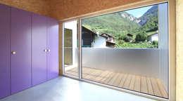 MMR _ maison à réchy: Chambre d'enfant de style de style Moderne par évéquoz ferreira architectes