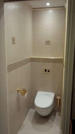 WC après: Salle de bains de style  par CLAI