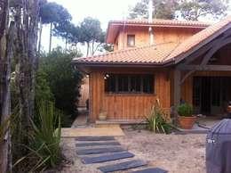 Façade ouest avec sa grande terrasse couverte: Maisons de style de style eclectique par Concept Home Setting