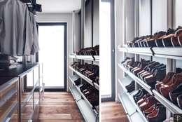 Closets de estilo  por Studio Potorska