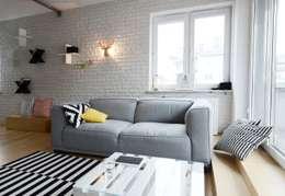 Apartament Praga : styl , w kategorii Salon zaprojektowany przez Devangari Design