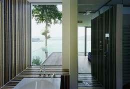 Baños de estilo  por Arkan Zeytinoglu Architects