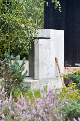Grill w obrębie tarasu: styl skandynawskie, w kategorii Domy zaprojektowany przez Magdalena Zawada