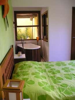 Dormitorios de estilo topical por Metamorfose Arquitetura e Urbanismo