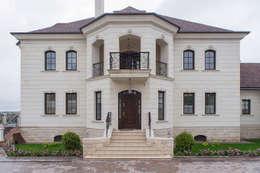 Casas de estilo clásico por Архитектурная студия