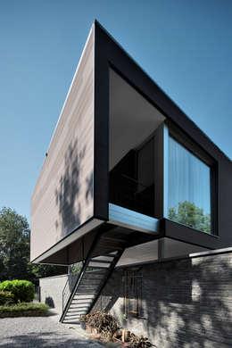 Projekty, nowoczesne Domy zaprojektowane przez atelier d'architecture FORMa*