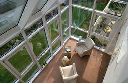 Jardin d'hiver de style  par Haacke Haus GmbH Co. KG