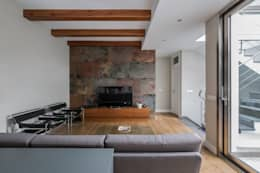 Casa Trinidad: Salones de estilo moderno de LLIBERÓS SALVADOR Arquitectos