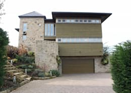 Casas de estilo ecléctico por Wildblood Macdonald