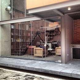 Fachada: Casas de estilo industrial por Quinto Distrito Arquitectura