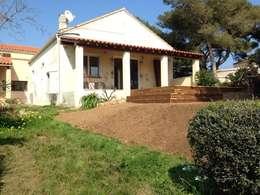 Talutage et mise en forme terminé: Terrasse de style  par In&Out Garden