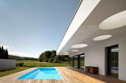 Projekty, nowoczesne Domy zaprojektowane przez spado architects