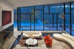 Salas de estar modernas por Robert Gurney Architect