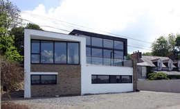 Casas de estilo moderno por Atelier de l'Ile