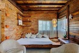 Salas / recibidores de estilo rústico por Ferraro Habitat