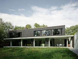Projekty, eklektyczne Domy zaprojektowane przez :mlzd