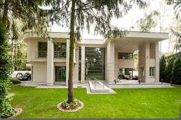 LK&907 realizacja: styl nowoczesne, w kategorii Domy zaprojektowany przez LK & Projekt Sp. z o.o.