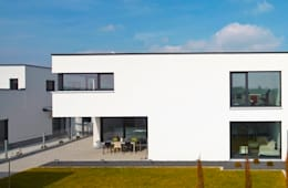 Projekty, minimalistyczne Domy zaprojektowane przez lc[a] la croix [architekten]