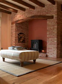 rustieke & brocante Woonkamer door CCD Architects