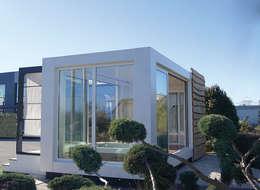 Studio jardin: Garage / Hangar de style de style Moderne par .oboo-outdoor