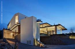 Fachada noroeste: Casas de estilo moderno por BROISSIN