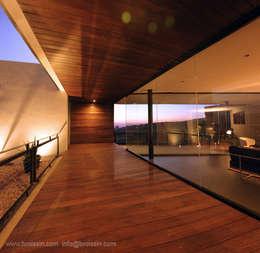 Acceso pasillo: Casas de estilo moderno por BROISSIN