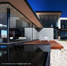Terraza jardín: Casas de estilo moderno por BROISSIN