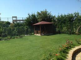 HEBART MİMARLIK DEKORASYON HZMT.LTD.ŞTİ. – Ali Özcan Evi: modern tarz Bahçe