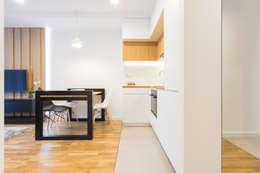 Cocinas de estilo moderno por UNQO