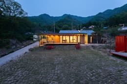 西景答家 서경답가: KAWA Design Group의  주택