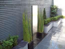 Jardines de estilo moderno por Unique Landscapes
