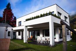 Projekty, nowoczesne Domy zaprojektowane przez room architecture