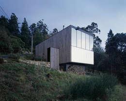 Projekty, nowoczesne Domy zaprojektowane przez Room11 Architects