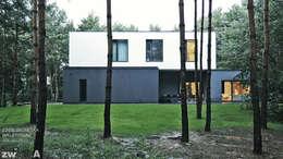 M - house: styl nowoczesne, w kategorii Domy zaprojektowany przez zwA Architekci